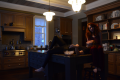 kitchen house modern island marble countertop two young women girls lying head in lap redhead red hair dress gauzy chiffon mysterious surreal eating popcorn portrait