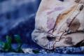 film photograph stone rock old canvas bag burlap stain colorful paint purple brown plant boke blur soft