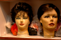 photograph of mannequin heads strange creepy wig market seller bizarre grotesque weird lips peeling red color surreal