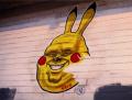 graffiti wall white bricks paint pikachu fat old double chin pokemon funny street art