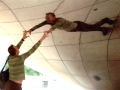 film photograph young man stretching reaching reflection metal chicago bean tourist perspective