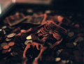skeleton toy box coins donations bills dollars lying shadows creepy death