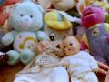 pile stuffed animals care bear barney dolls baby creepy flea market toppled fallen lying
