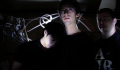 digital photograph light dark chiaroscuro long exposure contrast flash streak shadows young men three boys mysterious hidden leaning resting shoulder comforting