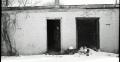 black and white film portrait photograph vintage retro WWII uniform young men winter snow aiming bunker