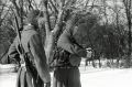 black and white film portrait photograph vintage retro WWII uniform young men winter snow machine guns