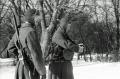 black and white film portrait photograph vintage retro WWII uniform young men winter snow machine guns