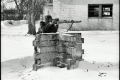 black and white film portrait photograph vintage retro WWII uniform young man winter snow aiming bunker