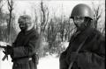 black and white film portrait photograph vintage retro WWII uniform young men winter snow smiling helmet fur hat