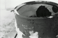 black and white film photograph bokeh garbage can buried treasure funny graffiti