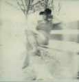 polaroid vintage retro film black and white blurry grainy park tree bench young lady woman african american dress boots poised hat
