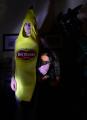 digital photograph young man banana del monte costume suit holding stuffed monkey ape gorilla scowl surreal stare shadows chiaroscuro lighting