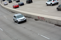 digital photograph highway freeway barrier graffiti no home red spray paint cars
