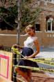 young woman girl african american dress white lace caution tape posing