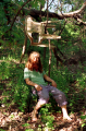 young man long hair red flowing beard hippie forest sitting plastic lawn chair in tree surreal funny