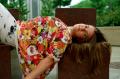 film photograph portrait girl lying big floral shirt