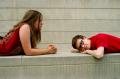 film photograph portrait boy girl lying stone wall red shirt looking friends