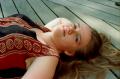film photograph portrait girl lying wooden planks blue eyes dirty blond