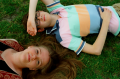 film photograph portrait girl boy lying friends grass smiling