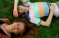 film photograph portrait girl boy lying friends grass smiling