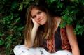film photograph portrait evergreen girl sitting head in hands dirty blond blue eyes