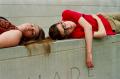 film photograph portrait boy girl lying stone wall red shirt friends