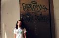 film photograph portrait young woman graffii wall