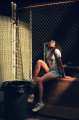 film photograph portrait young woman looking up chicken wire fence garbage can