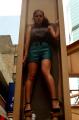 young woman girl model brunette wavy hair standing inside column high heels