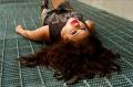 young woman girl model brunette wavy hair lying back grate grating vent
