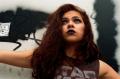 young woman girl model brunette wavy hair headshot graffiti black lipstick