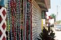 film photography bead curtain bottle caps beer bar street
