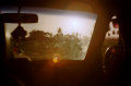 film photography view from car windshiel sun spots tropical silhouette