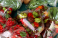 film photograph food market peppers red green plastic bags