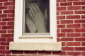 trompe loeil window trick photograph woman hand mouth picture brick wall