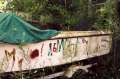 film photograph abandoned boat graffiti