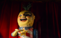 creepy pineapple man figurine retro