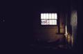 film photograph dark shadows chiaroscuro abandoned building graffiti window