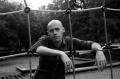 film photograph portrait black white playground man posing climbing rope net