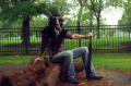 film photograph portrait sitting umbrella man goat mask creepy