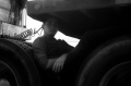 film photograph portrait young man resting chilling tires truck