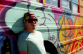 film photograph portrait graffiti bus young man sunglasses