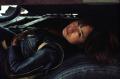 film photograph portrait young man resting tires truck