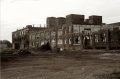 abandoned warehouse crumbling sepia black and white