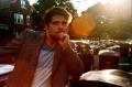 portrait film young man jacket pensive leaning