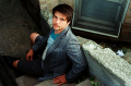 portrait film young man jacket pensive sitting stairs aerial view