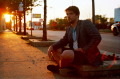 portrait film young man jacket pensive sitting sun spot sunset