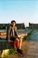 portrait film young man jacket pensive sitting abandoned wall