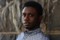 film photograph portrait headshot young african american man polka dot button down shirt handsome