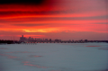 film photograph beautiful sunset winter bay red sky frozen water lake